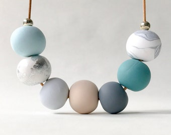 Sea green, blue and silver beaded clay necklace