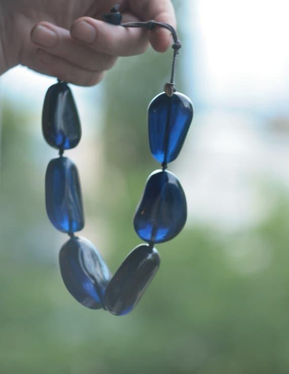 vintage high fashion jewelry signed jewelry extra large bohemian boho Early Manouk statement necklace in blue large plastic beads