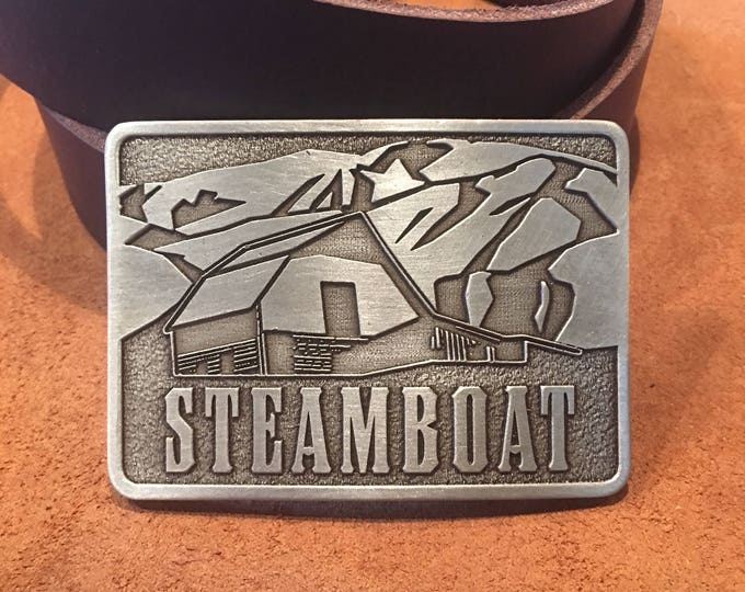 "Steamboat Springs Skiing Brass/pewter belt buckle 3""x2"""