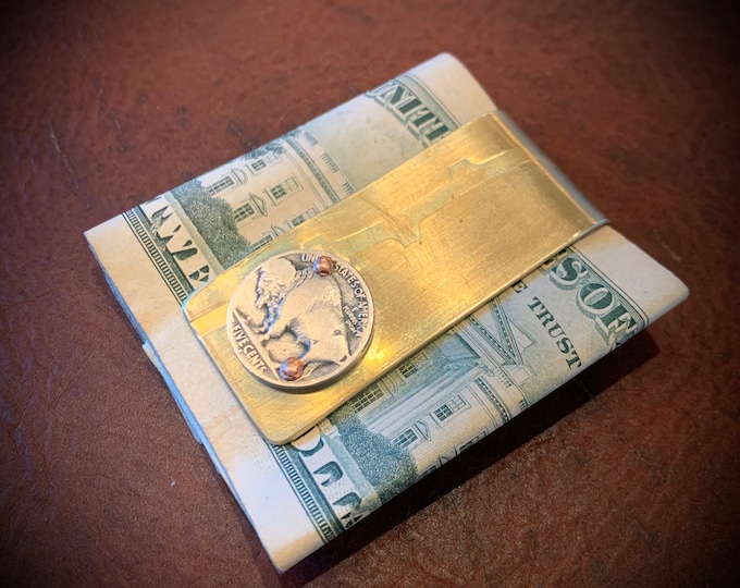 Repurposed Artillery shell Money clip from Vietnam war.