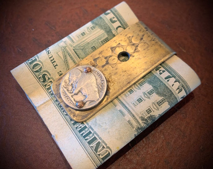 Up cycled Artillery Shell casing money clip from Vietnam war.