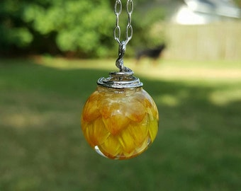 Dainty bright yellow strawflower in crystal clear resin orb pendant