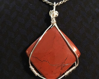 Red wire wrapped stone pendant
