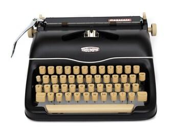 Black typewriter working Triumph typewriter vintage