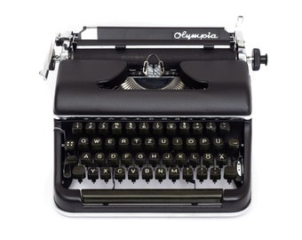 Black typewriter OLYMPIA SM2   working typewriter vintage   1950s typewriter black