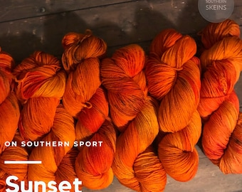 Sunset: hand dyed on Southern Sport. 75 % Superwash merino wool and 25 nylon. 100g. 328yds. Ready to ship. Free Shipping