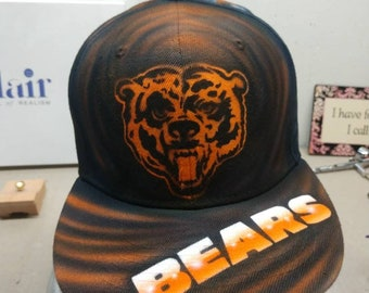 new arrival 55884 d83fa Custom Airbrushed Chicago Bears flat brimmed snapback hats.