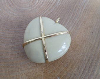 Vintage Estee Lauder 'Aliage' Solid Perfume Compact Pendant - heart shaped,rich cream enamel,gold tone cross,with contents