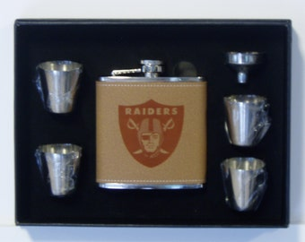 6adecdb91457 Oakland Raiders engraved leather 6 oz stainless steel flask with 4  stainless steel shot glasses and a funnel in a black presentation box