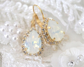 Antitrust in the Global Trading System Reconciling U.S. Japanese and Eu Approaches White opal Bridal earrings Swa