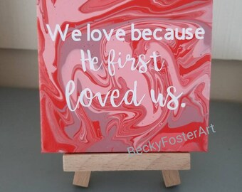 1 John 4:19 - 4x4 acrylic pour painting on canvas with vinyl text - mini display easel included