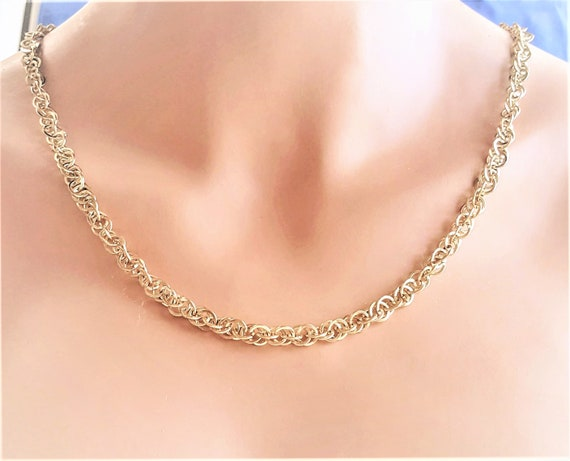 dainty silver tone chain with flat spiral links. Trifari Flat link necklace