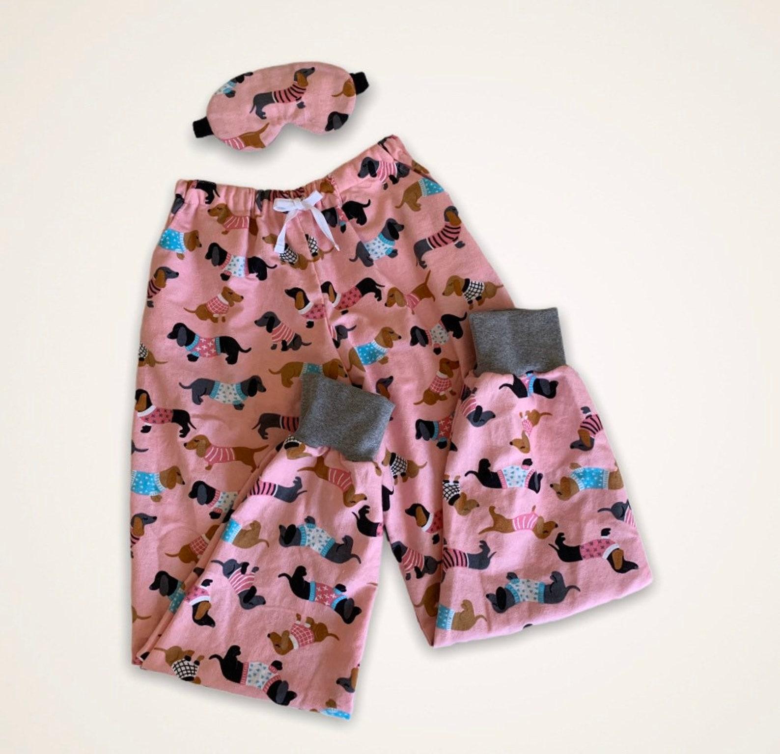 Pink flannelette pyjamas with dachshund print