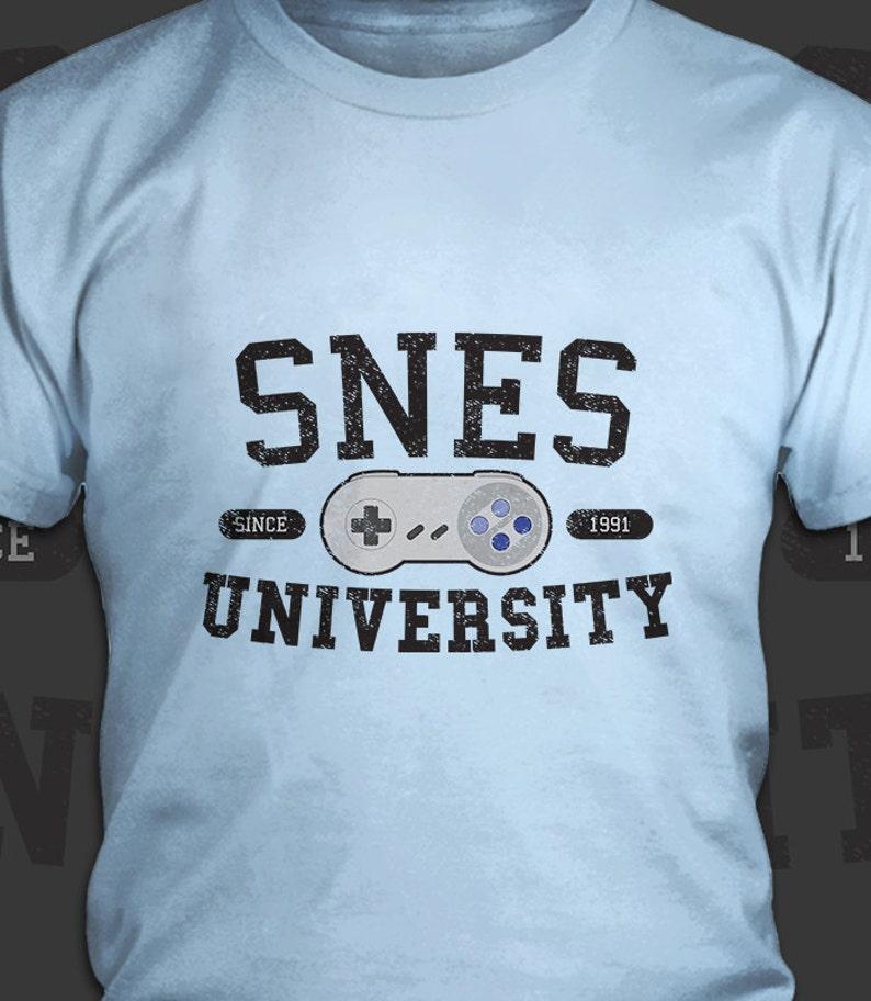 4a35ae66 SNES University Super Nintendo Entertainment System T-Shirt | Etsy