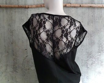 black shirt with lace insert on the back, top made of organic cotton, top with short, cut sleeves