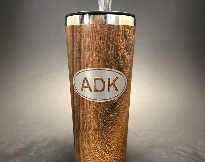 ADK Euro Oval laser etched in a woodgrain 22 oz insulated tumbler