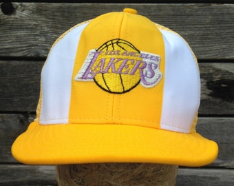 6705445f4c6b6 80s vintage Los Angeles Lakers snapback hat   One Size fits all   mesh  trucker cap