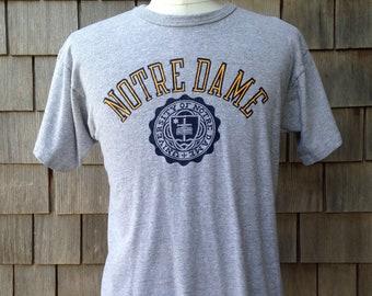 80s vintage Notre Dame Fighting Irish T shirt by Champion - Medium - University crest seal