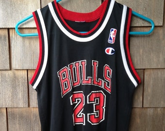 e27a285ea 90s vintage Michael Jordan  23 Champion jersey   youth medium   Chicago  Bulls