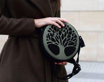 round bag. circle bag. green crossbody bag. round crossbody. circle shoulder bag. round shoulder bag. leather round bag. green circle bag