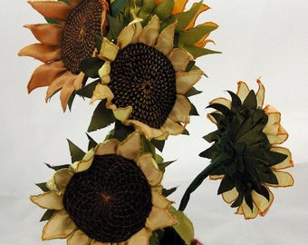 Machine embroidered sunflowers. Textile flowers which can be used as hair flowers, bouttonieres, buttonholes, or in a bouquet