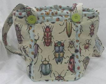 Beautiful tapestry Insects cover this handmade Vegan shoulder bag.