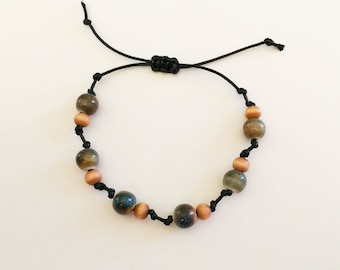 Black cord bracelet with ceramic and wood beads, strung cord jewelry, simple beaded bracelet