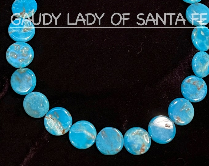 Turquoise penny-shaped flat circles.  Bright Blue