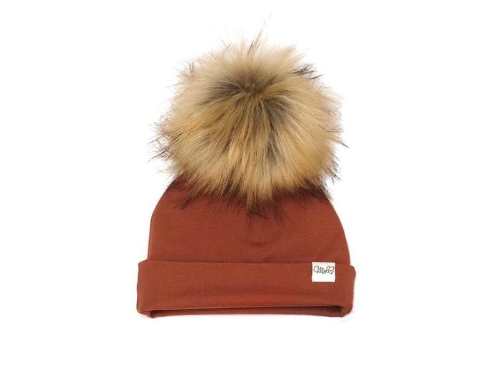Copper pompom cap