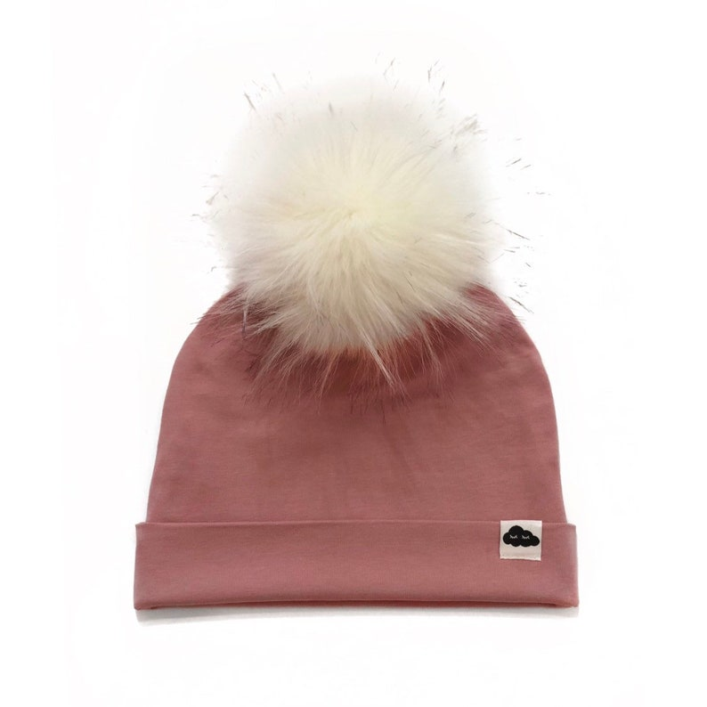 Pink pom-pom cap