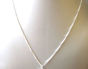 silver chain with sapphire blue crystal pendant