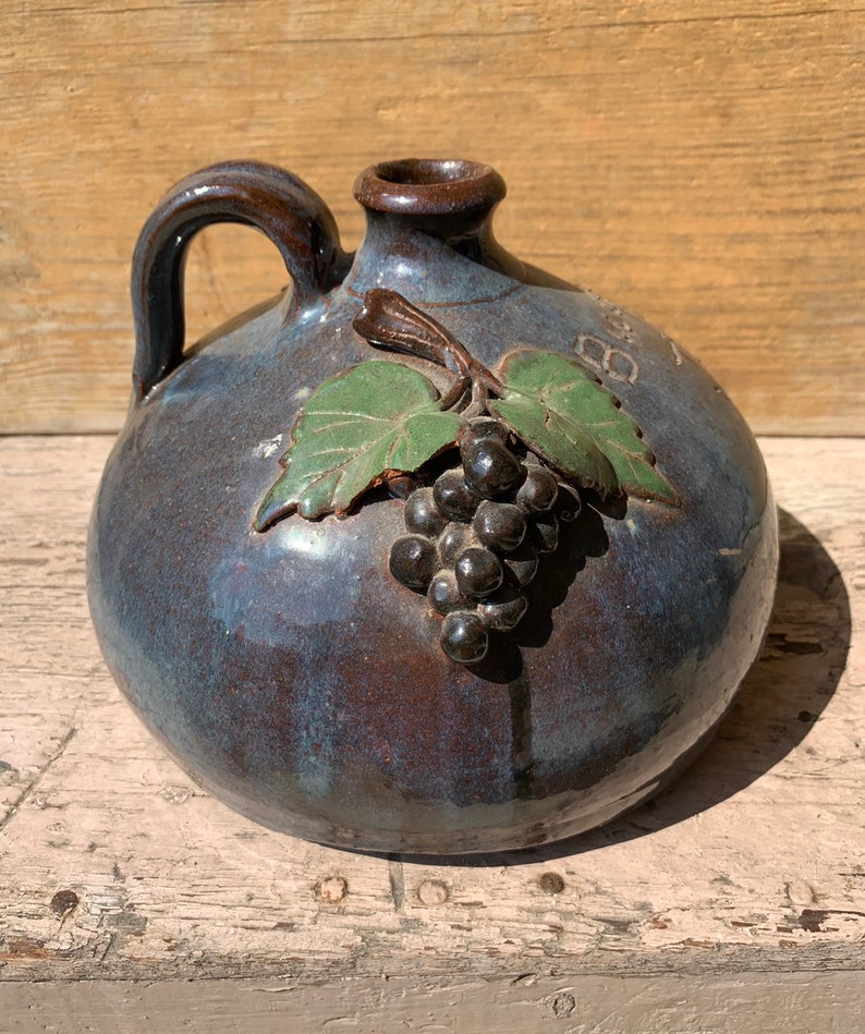 Large Signed Bobby Ferguson Buggy Jug Blue with Grape Clusters and Vines