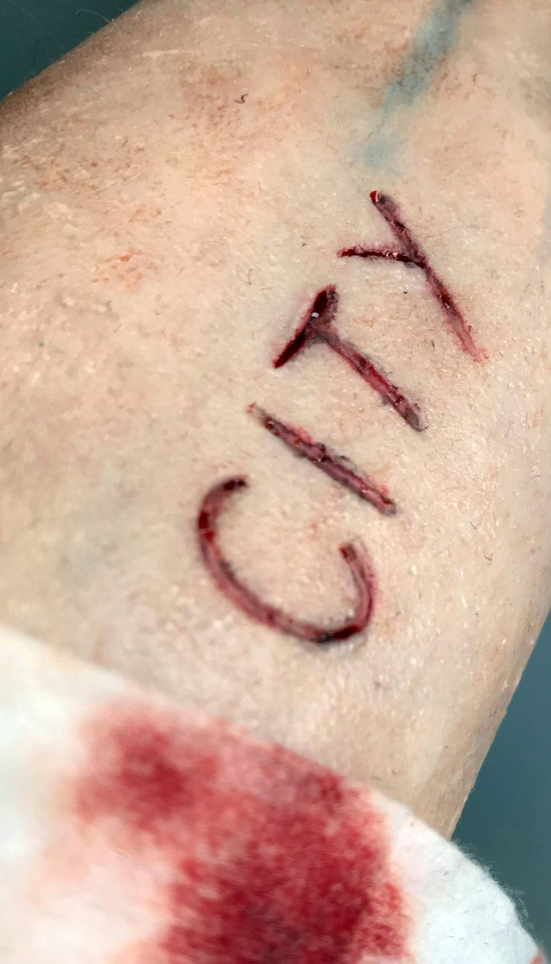 SFX Prosthetic silicone city cut mark Football fans gone mad.