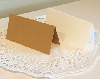 Pack of 10 Blank name cards 50x100mm (when folded) either kraft or white textured card