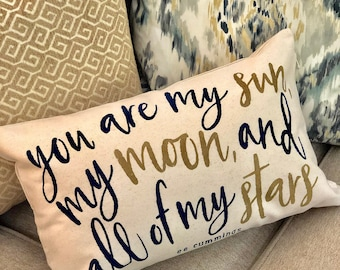 20 inch lumbar pillow with ee cummings Sun, Moon, Stars saying from Glendi Designs