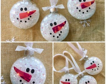 Snowman face Christmas tree ornament glass snowman snow filled