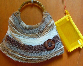 Hand knitted large purse with coin pouch and hand sanitizer clip on. Leather Flower