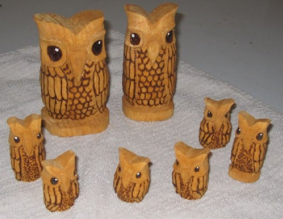 Hand carved white pine wooden owls available as per each 4 inch table model and 6 inch pendant with leather lanyard