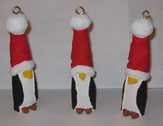 Penguin Christmas ornaments 4 inches tall hand carved and hand painted in folk art style.