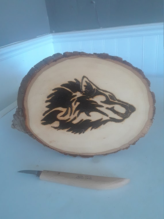 Howling Wolf wood burning on 7 x 9 inch wood slab. The pyrography mystical wolf really looks good with the original bark and clear finish.