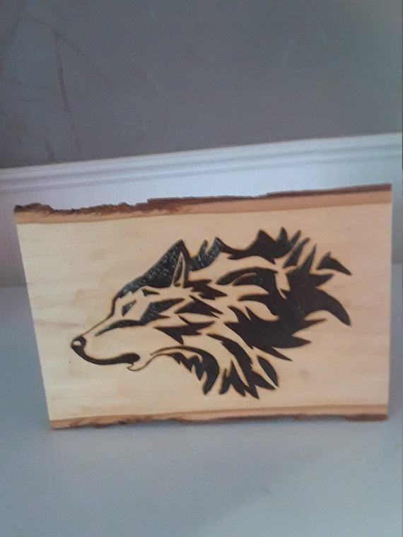 Howling Wolf wood burning on 7 x 11 inch wood slab. The pyrography mystical wolf really looks good with the original bark and clear finish.