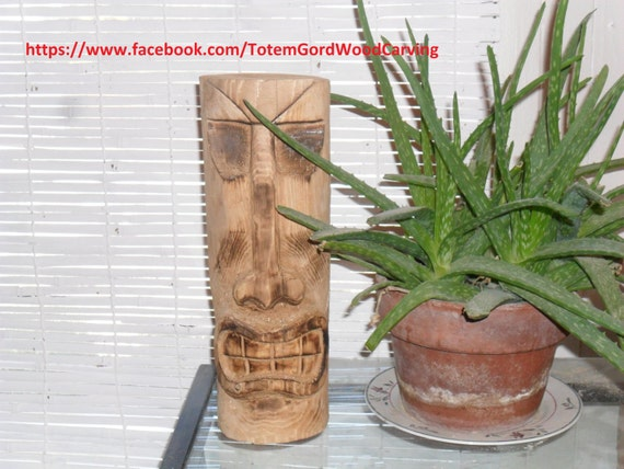 Tiki Head hand carved 12 inch tall with a ferocious smile to be a great conversation starter
