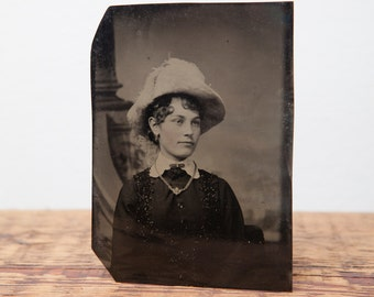 Antique tintype of young girl in hat