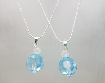 Light Blue, Multi Faceted, Circular Swarovski Crystals on a Sterling Silver Chain
