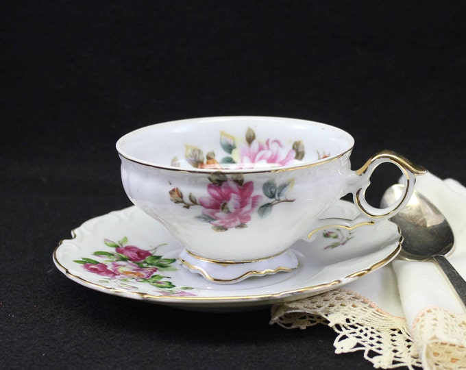 Ucagco Footed Tea Cup and Saucer with Pink Roses.  Hallmarked tea cup set Made in Japan,