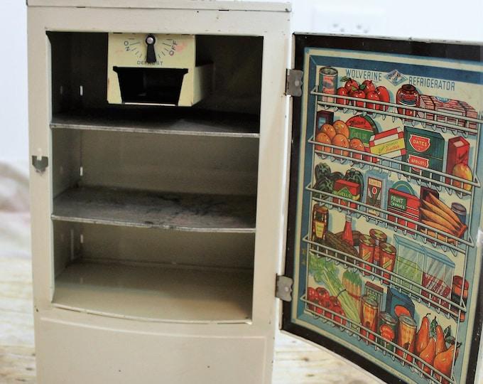 Vintage Wolverine children's metal refrigerator, circa 1940. Tin Toy