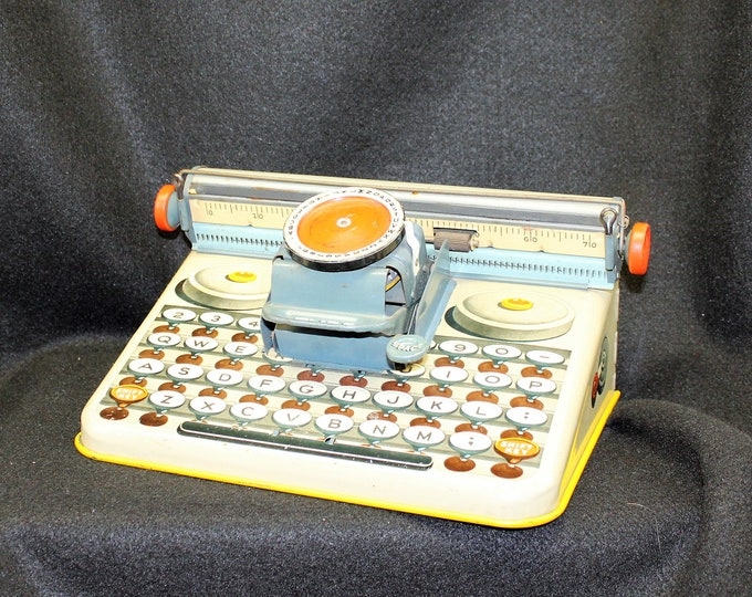 Vintage children's metal typewriter.  Tin Toy. This item is circa 1950's made by the Dependable company.