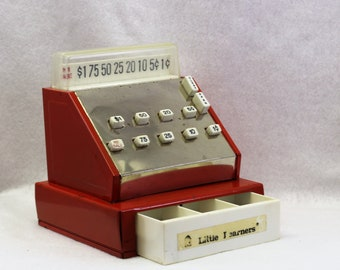 Vintage red metal toy cash register. Vintage Little Learners cash register play. Tin Toy