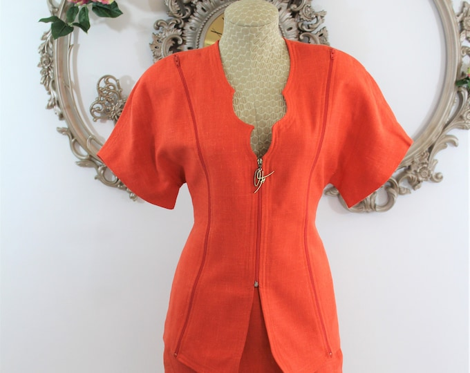 Short sleeved orange skirt set with zippered details US size 4-6. Parisian Woman's suit by Orna Forho in French size 38.