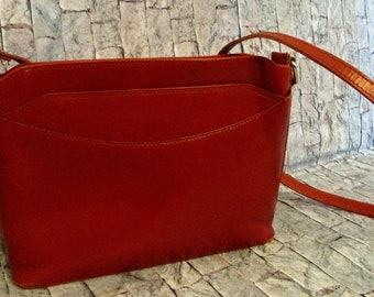 Persaman New York, made in Italy, leather. Shoulder strap. Brown purse.